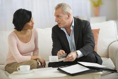 Woman talking to financial advisor - stock photo
