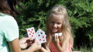 Stock Video Footage of Mother and Child, Little Girl Playing Cards Game in Park, Happy Family