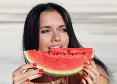 girl eats a water-melon - stock photo