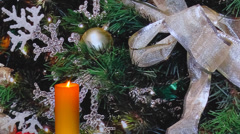 Glowing golden holiday candle, snowflakes, ribbons Stock Footage
