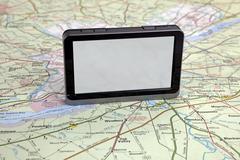 gps navigation on green map. - stock photo