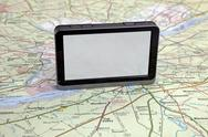 Stock Photo of gps navigation on green map.