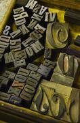 Close up of fonts from antique printing press - stock photo
