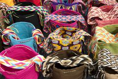 colorful handmade shoulder bags guajira colombia - stock photo