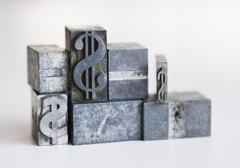 Stock Photo of Close up of printing blocks with dollar sign