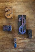 Stock Photo of Close up of printing blocks with dollar sign on wood