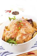 Golden chicken in baking dish. Stock Photos