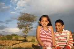 two kids looking at camera in countryside san gil colombia - stock photo