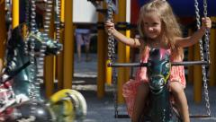 Smiling Little Girl Playing, Spinning in Carousel, Child at Playground, Children Stock Footage