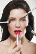 Stock Photo of Woman having make up applied