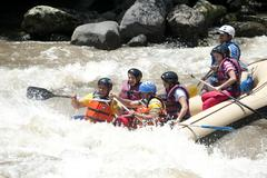 family doing a white water rafting san gil colombia - stock photo
