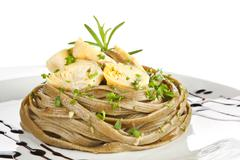 Tagliatelle with artichoke and fresb herbs. Stock Photos