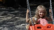 Child Swinging, Girl Playing with Teddy Bear Toy at Playground in Park, Children Stock Footage