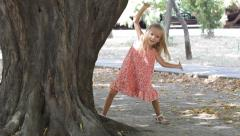 Child Playing Peak a Boo in Park, Girl Hiding by a Tree, Hide and Seek, Children Stock Footage