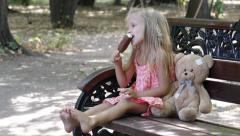 Child, Little Girl Eating, Licking Ice Cream on Hot, Torrid Summer Day, Children Stock Footage