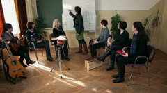 group of people that are learning a new song - stock footage