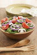 Stock Photo of Fresh salad in bowl on table
