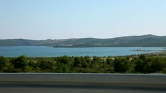 Shot of the landscape near adriatic sea,  taken from a driving car. Stock Footage