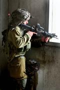 Israeli soldier looks through a gun-sight Stock Photos