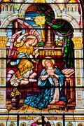 angel appearing mary stained glass saint peter paul catholic church san franc - stock photo
