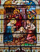 jesus nativity scene stained glass saint peter paul catholic church san franc - stock photo