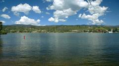 Pan across lake to wooden bridge Stock Footage