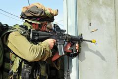 israeli soldier shoots during urban warfare exercise - stock photo