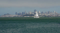 Sailboat in front of San Francisco skyline Stock Footage