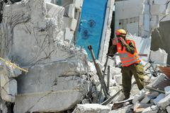 Search and rescue through building rubble after a disaster Stock Photos