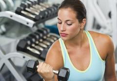 Stock Photo of Woman exercising with dumbbells