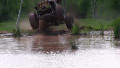 Big Jeep Jumps into Pond Stock Footage