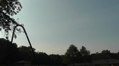 Silhouette of a Girl on a Swingset Swinging High Stock Footage