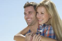 Stock Photo of Portrait of mid adult couple against blue sky