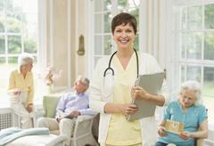 Nurse and senior people in nursing home Stock Photos