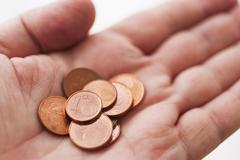 Hand with one cents coins - stock photo