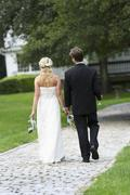 Stock Photo of Newly wed couple walking together