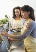 Two female business owners in restaurant - stock photo
