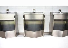 stainless urinals - stock photo