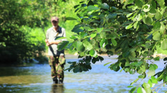 Fishing on the river. Fisherman catching a fish. Environment,ecology,pure water. Stock Footage