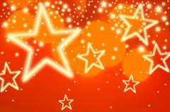 Stars on orange background, studio shot - stock illustration