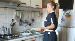 Housemaid Washing Dishes in the Kitchen Stock Footage