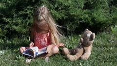 ULTRA HD 4K Child, Bear Toy Reading a Story Book, Girl Playing in Park, Children Stock Footage