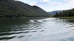 Panoramic shot of river Krka`s shore made from the moving boat Stock Footage