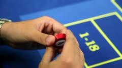 Betting at roulette table Stock Footage