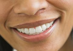 Close-up of woman's perfect teeth Stock Photos