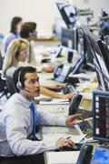 Traders at trading desk Stock Photos