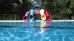 Colorful Water Slides in an Empty Clear Swimming Pool Stock Video Stock Footage