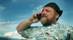 Man talking on the mobile phone on vacation Stock Footage