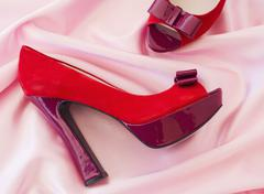 Pair of red high heel open toe shoes on pink textile Stock Photos