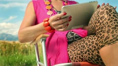 Woman searching on the internet on tablet PC in nature Stock Footage